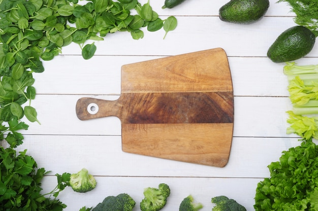 Wooden cutting board and vegetables, healthy food concept
