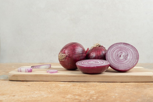 A wooden cutting board with sliced onion