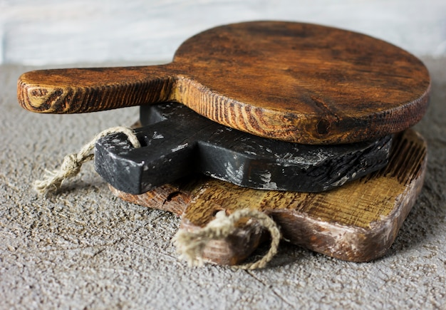Wooden cutting boards on grey concrete background. props for food photography