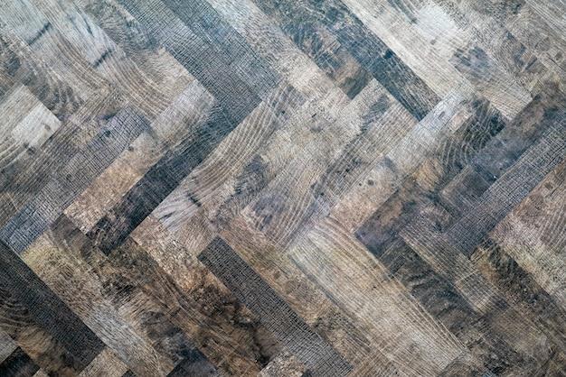 Пол деревянный темный паркет. абстрактная второстепенная текстура.