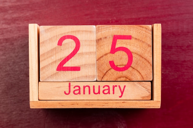 Wooden date for chinese new year on red background