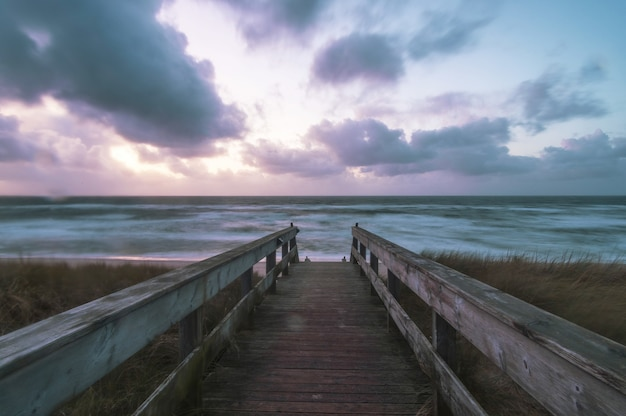 Wooden deck on the beach surrounded by the sea at the island sylt in germany