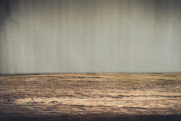 Wooden deck table on grunge background