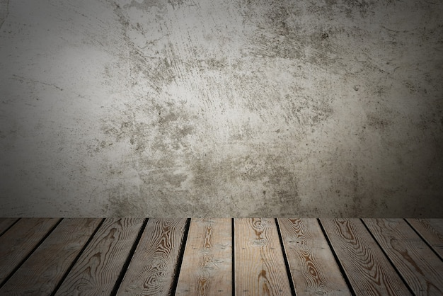 Wooden decking table on a grey grunge background. place for an item, logo, or label. layout, mockup.