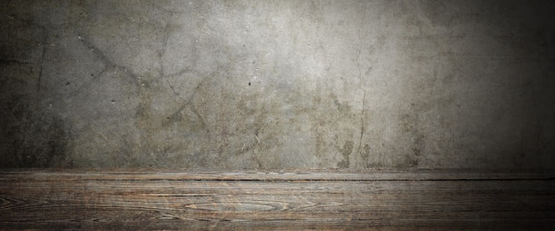 Wooden decking table on a grey grunge background. place for an item, logo, or label.