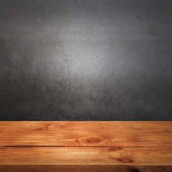 Wooden decking table on a grey grunge background. place for an item, logo, or label