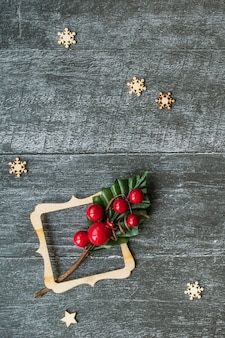 Wooden decorative gift and red bow on the wooden board