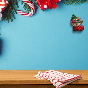 Wooden desk on  blue wall decorated with christmas ornaments