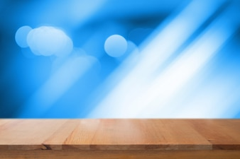 Wooden desk with blue gradient tone abstract background bokeh circles for Christmas background