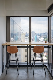 Wooden desk with chairs at corner modern office in downtown