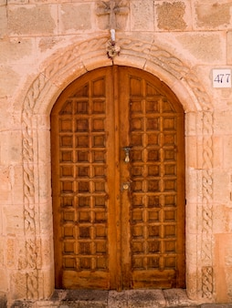 Wooden door and stone wall in rhodes greece