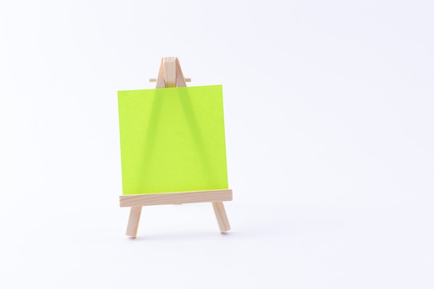 Wooden easel miniature with blank colored square canvas or memo paper