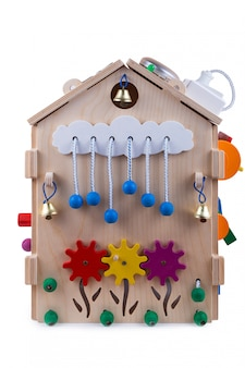 Wooden eco-friendly busy board house. educational toy for children