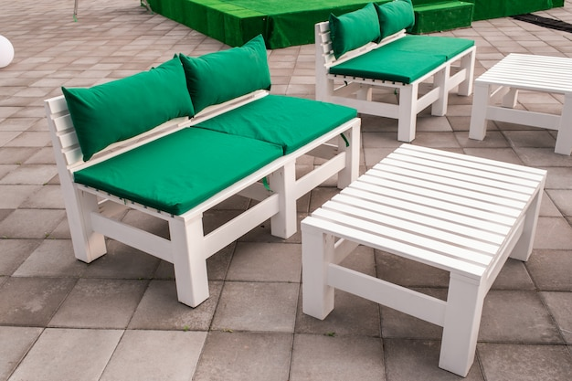 Wooden ecological furniture, table and sofa in the construction of wooden pallets furniture from pallets