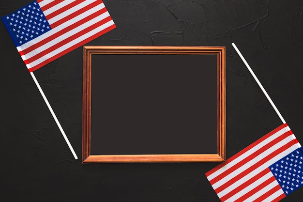 Wooden empty frame with place for text. american flags. for the independence day of the united states.