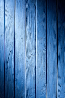 Wooden fence planks background painted in cyan