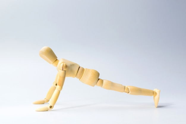 Wooden figure doll with push up for health on white  for exercise training
