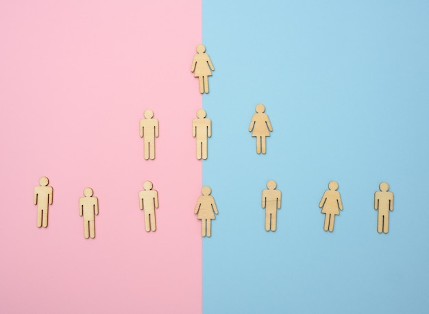 Wooden figures on a blue pink background, hierarchical organizational structure of management, effective management model in the organization,  top view
