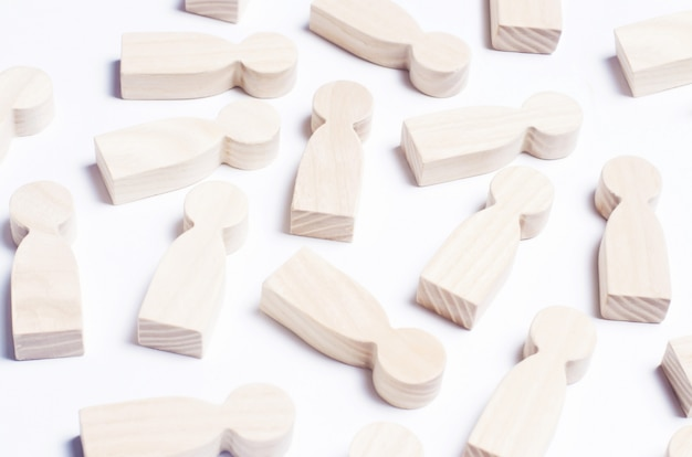 Wooden figures of people on a white background