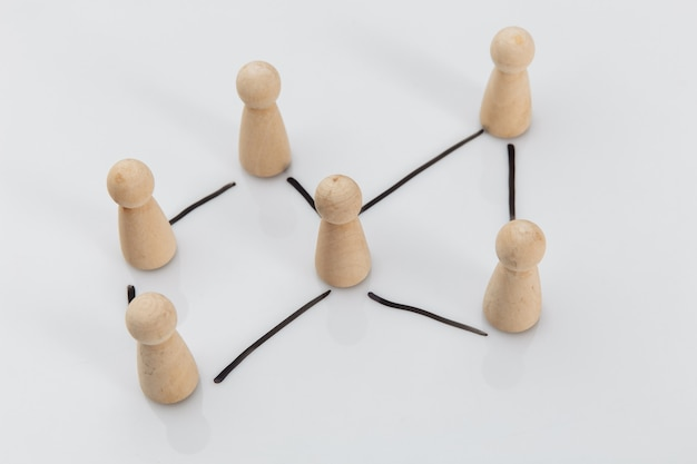 Wooden figures of people on a white table, business concept, human resources and management concept.