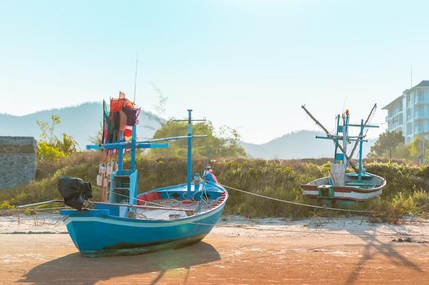 Wooden fishing boat on an island sand beach