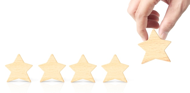 Wooden five star in hand shape. best excellent business services