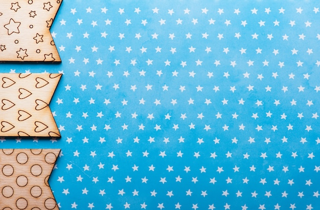 Wooden flags with stars and hearts on blue background