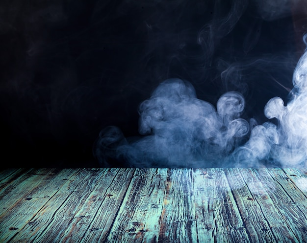 Wooden floor against the backdrop of clouds of smoke