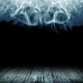 煙の雲を背景にした木の床