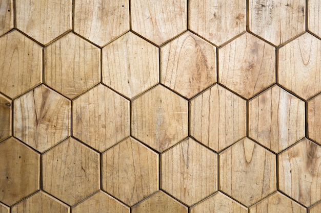 Wooden floor in form of honeycomb background
