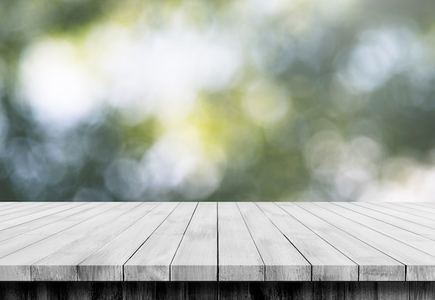 Wooden floor in front of blur bokeh backgrounds, use for display products.
