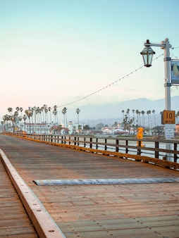 Wooden floor made of beams on a pier on the santa barbara waterfront, california at sunset