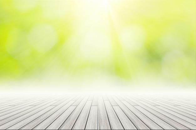 Деревянный пол сцены фон зеленый боке с солнечным светом