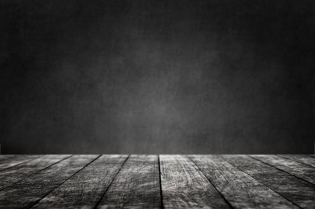 Pavimento in legno con sfondo nero del prodotto a parete