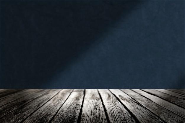 Pavimento in legno con sfondo blu del prodotto a parete