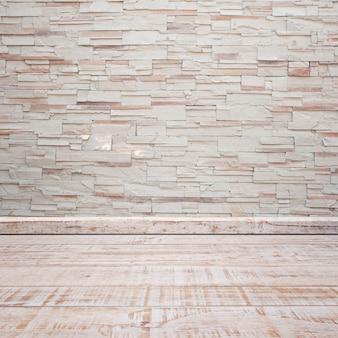 Wooden floor with brick wall