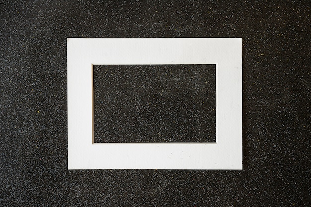 Wooden frame on black table