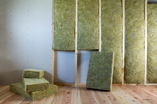 Wooden frame for future walls with drywall plates insulated with rock wool