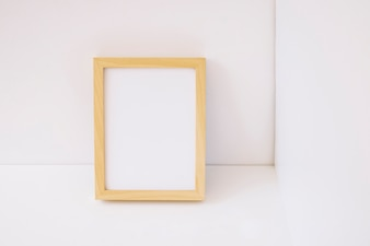 Wooden frame leaning against wall