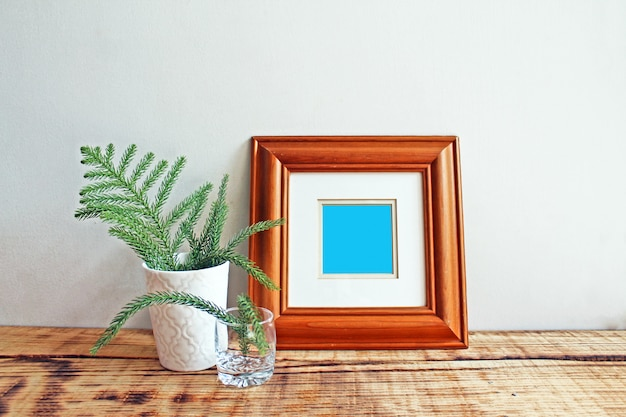 Wooden frame mockups with wooden background