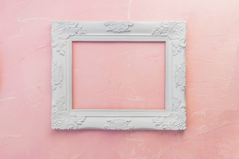 Wooden frame on pink table