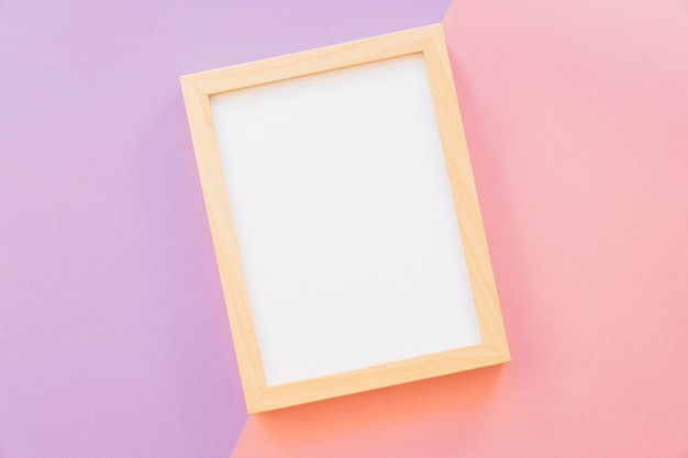 Wooden frame on pink and purple background