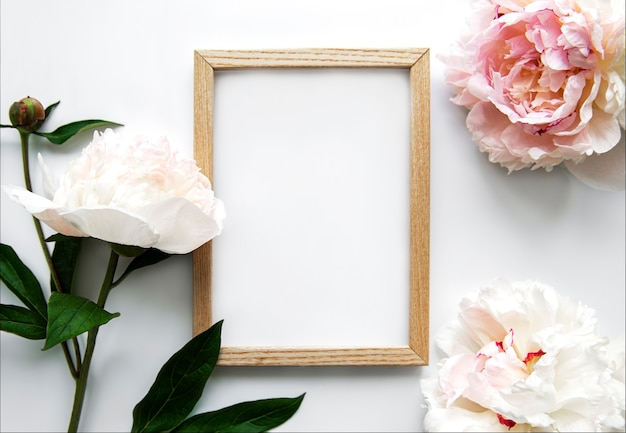 Wooden frame surrounded by beautiful pink peonies