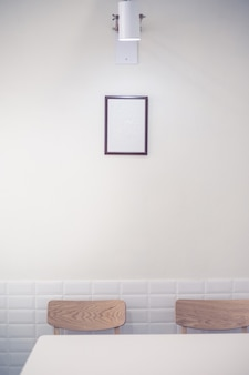 Wooden frame on white wall
