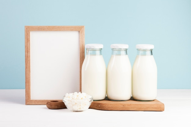 Wooden frame with bottles of milk