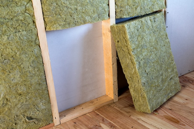 Wooden frame with drywall plates insulated with rock wool and fiberglass