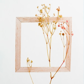 Wooden frame with flower branch
