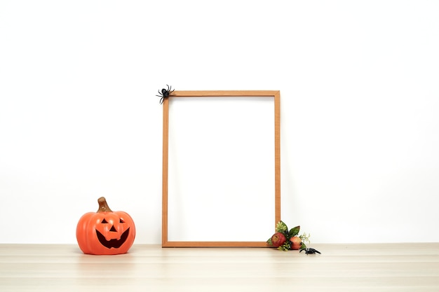 Wooden frame with jack o lantern lovely on decoration a shelf or desk with white wall with