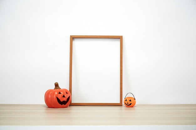 Wooden frame with jack o lantern lovely on decoration a shelf or desk with white wall