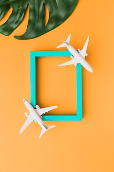 Wooden frame with toy planes